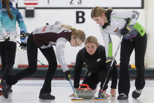 Curling Canada has proposed just one player from the throwing team sweeps, and the skip from the non-throwing team is prohibited from sweeping any rock behind the T-line of the house and must stay at the hack. (Tim Smith / The Brandon Sun files)