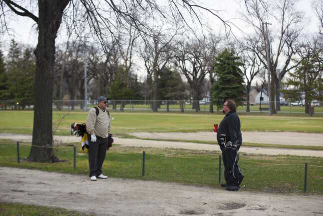 Winnipeg Free Press reporters Jason Bell (left) and Mike McIntyre wait for their turn to tee off the first day of golf in 2020 at Kildonan Park Golf Course Monday morning. (Mike Deal / Winnipeg Free Press)