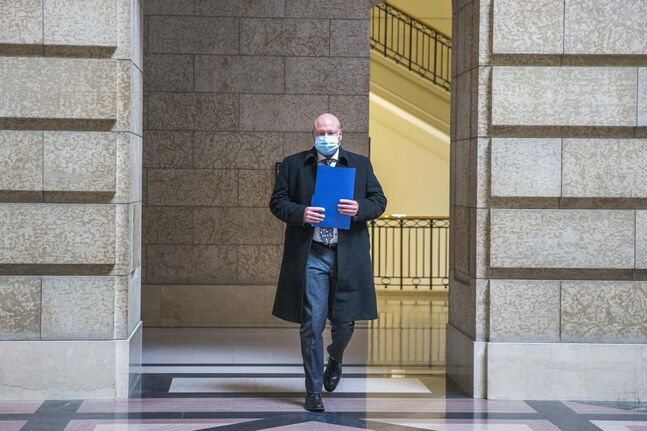 MIKAELA MACKENZIE / WINNIPEG FREE PRESS  Dr. Brent Roussin, chief provincial public health officer, walks through the Manitoba Legislative Building in Winnipeg on Wednesday, Nov. 4, 2020. For --- story.  Winnipeg Free Press 2020