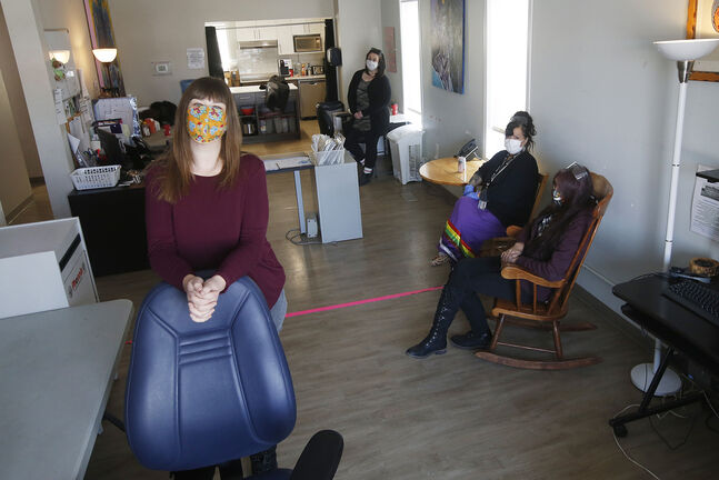 Rebecca Blaikie, director of community services at Mount Carmel Clinic, foreground, with Sage House staff, program manager Melissa Omelan-Barnes (from left), Sandy Banman and Flo Smith. (John Woods / Winnipeg Free Press)