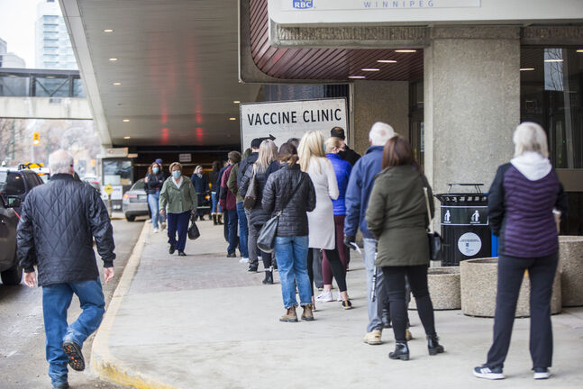 A lineup at the downtown vaccine supersite in March. (Mikaela MacKenzie / Winnipeg Free Press files)