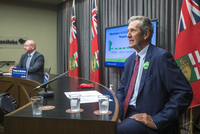 Premier Brian Pallister (right) and Dr. Brent Roussin, chief provincial public health officer. (Mikaela MacKenzie / Winnipeg Free Press files)