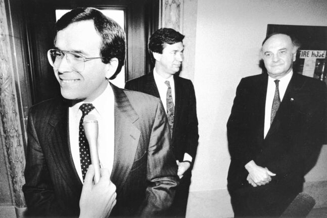 PHIL HOSSACK / WINNIPEG FREE PRESS  Gary Filmon speaks with media about power transfer as Gary Doer and Howard Pawley hover in the background. April 28, 1988  1988 Manitoba Provincial Election
