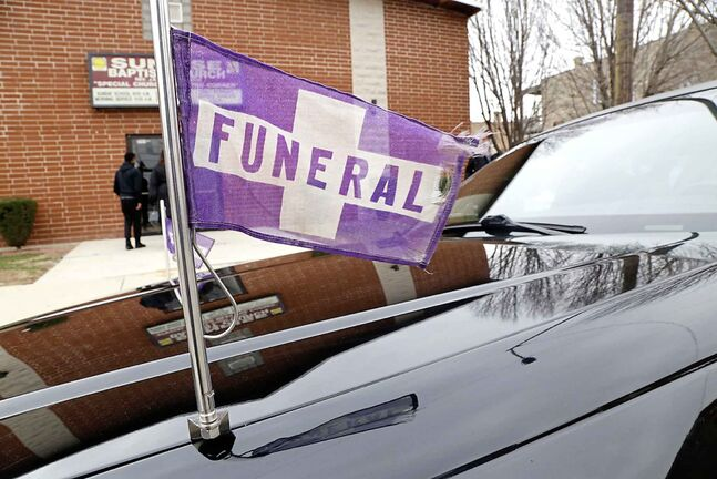 In Manitoba, many lead cars in the funeral procession are equipped with a flashing purple light and the other vehicles in the procession have flags on their windows. (Martha Irvine / The Associated Press Files)