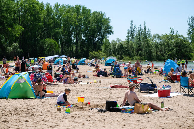 Daniel Crump / Winnipeg Free Press. Visitors to the beach at Birds Hill park soak up the sun on a hot summer day in June.