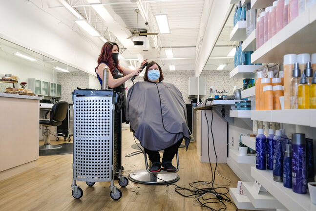 The risk factor is lower in places such as retail and hair salons where people mingle for shorter periods of time and mask use is mandatory. (Daniel Crump / Winnipeg Free Press)