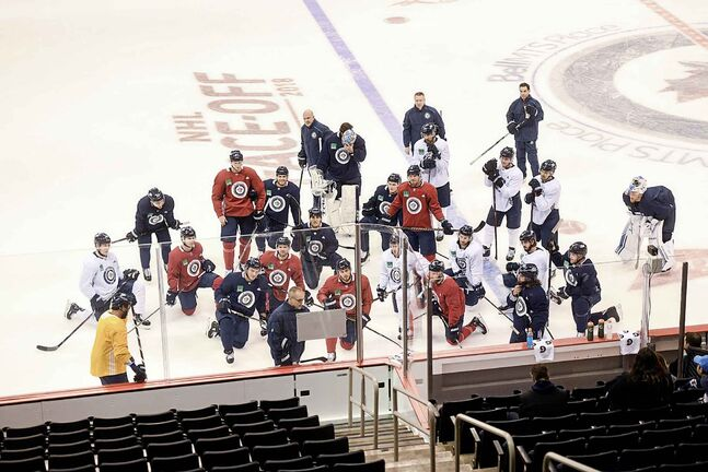 Winnipeg Jets Head Coach Paul Maurice goes over drills with the team at practice Wednesday afternoon at Bell MTS Place.