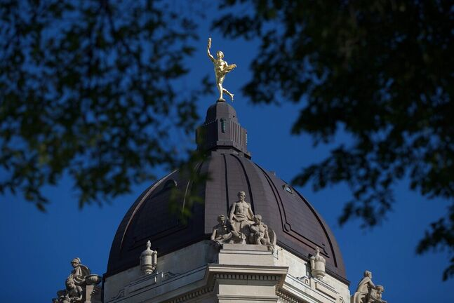 The Golden Boy stands on top of the dome of the Manitoba Legislature in Winnipeg, Saturday, August 30, 2014. Pigeon poop, leaking ceilings and damp, insect-infested trees are slowly degrading what is considered