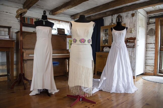 photos by ALEX LUPUL / WINNIPEG FREE PRESS</p><p>Dresses designed by Edna Nabess of the Mathias Colomb Cree Nation in the log house at The Nellie McClung Heritage Site in Manitou.</p>