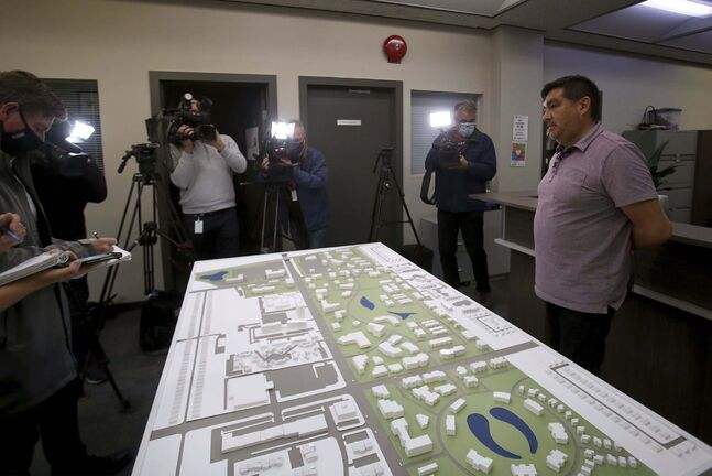 David Thomas, planning and design manager of Treaty One Development Corp., unveiled a model of  Naawi-Oodena being built on the site of the former Kapyong barracks. (Shannon VanRaes / Winnipeg Free Press)