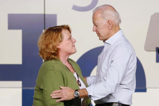 Sen. Heidi Heitkamp and former U.S. vice president Joe Biden during a rally Thursday. (Michael Vosburg / Fargo Forum)</p>
