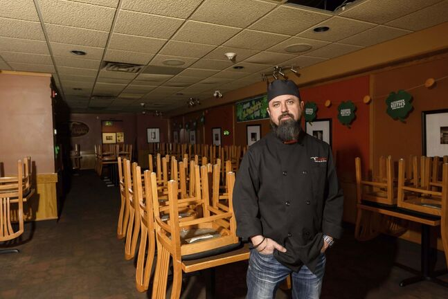 <p>Tony Siwicki, the owner of Silver Heights Restaurant, in his empty dining room Wednesday. He says he decided to close because it was the right thing to do. Then he scrambled to have Silver Heights listed on food-delivery sites.</p>