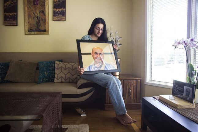 MIKAELA MACKENZIE / WINNIPEG FREE PRESS</p><p>Rooj Ali, 16, with a portrait of her father, Nour Ali, who died in a Lake Winnipeg boating accident on June 13.</p>