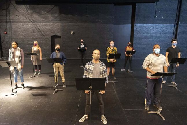 Playwright Ben Townsley, centre, and director Ray Strachan, right, with performers from One Trunk and Walk&Talk theatre companies rehearse at the Burton Cummings Theatre.</p>