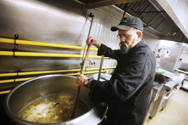 Andrew Tunny prepares soup for Union Gospel Mission's Thanksgiving meal.</p>