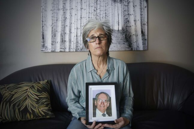 <p>Lisa Prost holds a photo of her father Murray Balagus, 91, who died last Thursday while a resident at Maples Personal Care Home.</p>