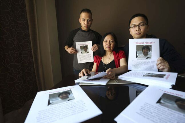 RUTH BONNEVILLE / WINNIPEG FREE PRESS FILES</p><p>The family of Eduardo Balaquit, who went missing in 2018. Balaquit's wife Lumie and sons Erwin (left) and Edward (right) hold posters they distrubuted in the community.</p>