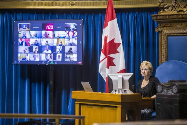 Speaker Myrna Driedger runs through a semi-virtual throne speech rehearsal, with some MLAs in the chamber while others connected via video-conferencing at the Manitoba Legislative Building in Winnipeg on Tuesday.