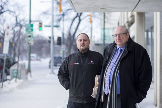 Todd Dube, founder of Wise Up Winnipeg (left) and Keith MacCharles, who is fighting two radar tickets, in front of the traffic courts in Winnipeg on Tuesday.
