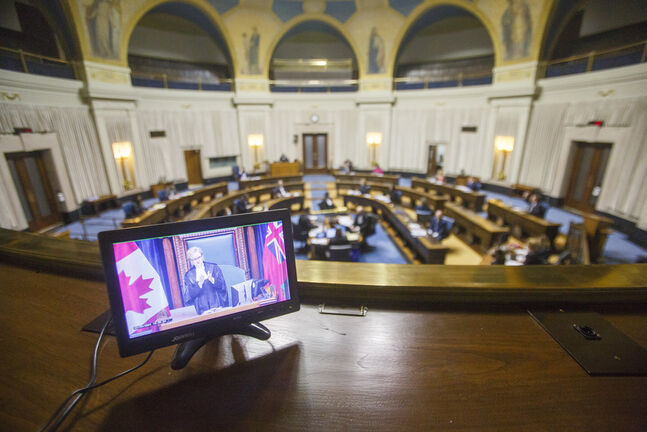 Speaker of the Legislative Assembly of Manitoba, Myrna Driedger, addresses the chamber, viewed from a monitor in the press gallery, at the Manitoba Legislative building Wednesday. (Mike Deal / Winnipeg Free Press)  210303 - Wednesday, March 03, 2021.