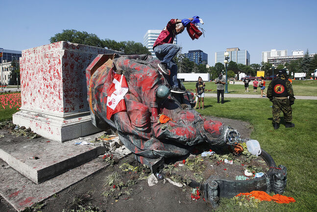 Statues of Queen Victoria and Elizabeth were toppled at the Manitoba legislature on Canada Day by protesters upset over residential-school burial sites. (John Woods / Winnipeg Free Press files)
