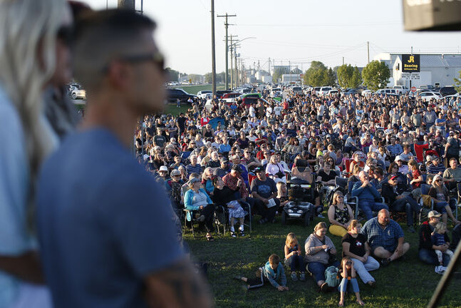 Hundreds of people came out to listen to speakers and show their discontent with COVID-19 restrictions in Winkler on Monday. (John Woods / Winnipeg Free Press)