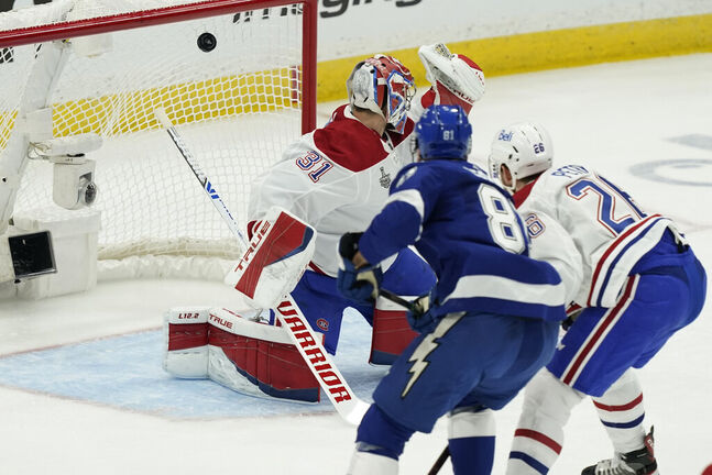 Erik Cernak scores on Carey Price during the first period Monday. (Gerry Broome / The Associated Press)