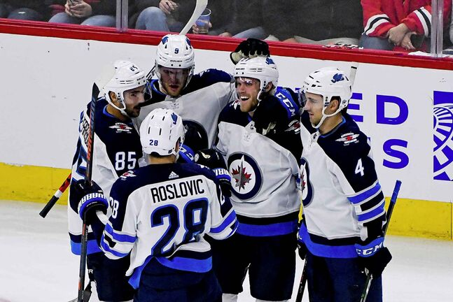 Winnipeg Jets left wing Nikolaj Ehlers, second from right, celebrates with teammates after scoring a goal during the second period of an NHL hockey game against the Chicago Blackhawks Saturday, Oct. 12, 2019, in Chicago. (AP Photo/Matt Marton)