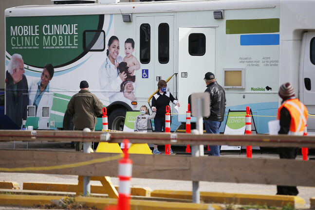The COVID-19 mobile testing centre at Portage Avenue and Erin Street has been busy since opening last week. (John Woods / Winnipeg Free Press files)