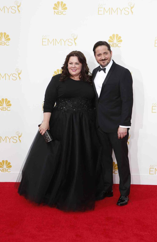 Melissa McCarthy (Mike & Molly) and husband Ben Falcone arrive for the 66th Annual Primetime Emmy Awards at Nokia Theatre at L.A. Live in Los Angeles Monday. (Tribune Media MCT)