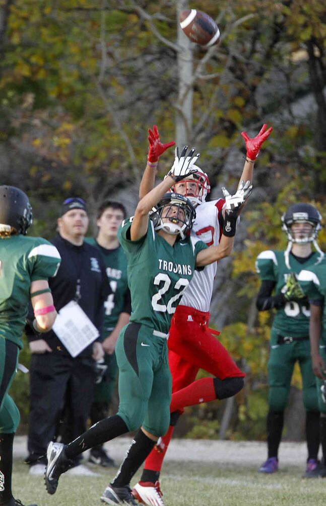 Vincent Massey Trojans' Carter Hague and Kelvin Clippers' Zack Boyko reach for the ball.