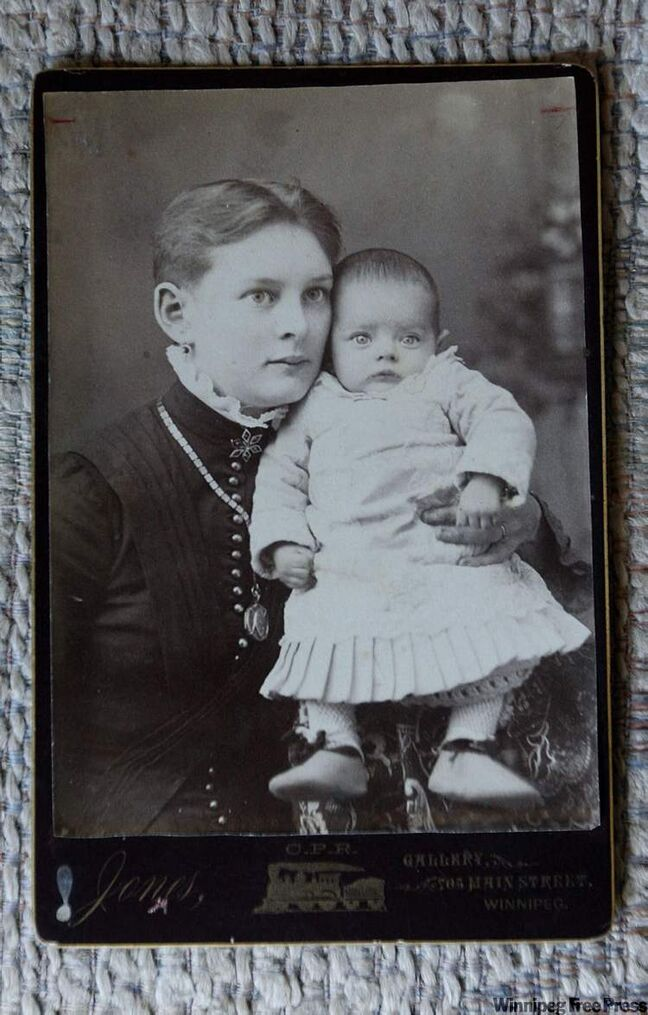 Unknown woman with baby.