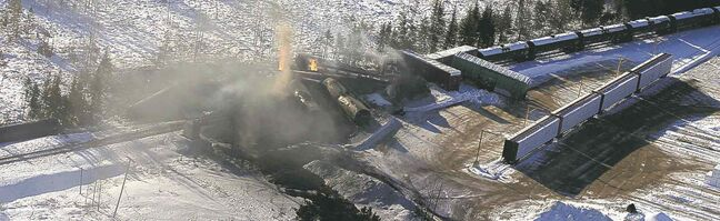 Derailed CN cars carrying crude oil and propane burn in Plaster Rock, N.B., after Tuesday's derailment.
