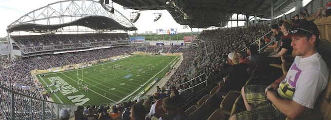 Fans take in the action at Investors Group Field.