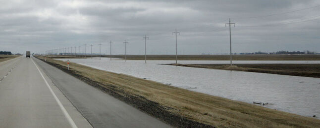 Melt water collects in the ditches along Hwy 75.