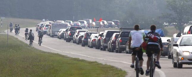 Campers in vehicles line up Wednesday morning to get in to the festival camping area.