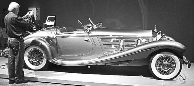A museum vistior photographes a 1937 Mercedes-Benz 540K Special Roadster at the Allure of the Automobile exhibit Friday, June , 10, 2011, at the Portland Art Museum, in Portland, Ore.  The Allure of the Automobile examines the golden age of automotive design by celebrating some of the world's finest cars from the 1930s to the early 1960s. During this era of brilliantly designed automobiles, engineering combined with artistry and craftsmanship to produce objects of unparalleled beauty. (AP Photo/Rick Bowmer)