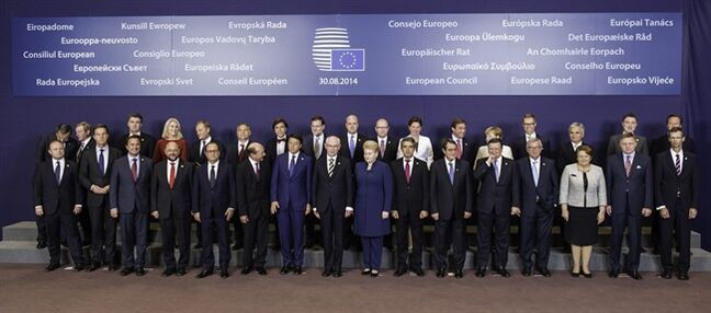 European Union leaders pose during a group photo at an EU summit in Brussels, Saturday, Aug. 30, 2014. EU leaders, in a one day summit, are set to decide who will get the prestigious job as the 28-nation bloc's foreign policy chief for the next five years. They will also discuss the current situation in Ukraine. Front row, left to right, Malta's Prime Minister Joseph Muscat, Dutch Prime Minister Mark Rutte, Luxembourg's Prime Minister Xavier Bettel, European Parliament President Martin Schultz, French President Francois Hollande, Romanian President Traian Basescu, Italian Prime Minister Matteo Renzi, European Council President Herman Van Rompuy, Lithuanian President Dalia Grybauskaite, Bulgarian President Rosen Plevneliev, Cypriot President Nicos Anastasiades , European Commission President Jose Manuel Barroso, European Commission President elect Jean-Claude Juncker, Latvian Prime Minister Laimdota Straujuma, Slovakian Prime Minister Robert Fico and General Secretariat of the Council Uwe Corsepius. Back row left to right, Greek Prime Minister Antonis Samaras, Irish Prime Minister Enda Kenny, Croatian Prime Minister Zoran Milanovic, Danish Prime Minister Helle Thorning-Schmidt, Polish Prime Minister Donald Tusk, Hungarian Prime Minister Viktor Orban, Belgian Prime Minister Elio Di Rupo, Spanish Prime Minister Mariano Rajoy, Swedish Prime Minister Fredrik Reinfeldt, Czech Republic's Prime Minister Bohuslav Sobotka, Slovenian Prime Minister Alenka Bratusek, Portuguese Prime Minister Pedro Passos Coelho, German Chancellor Angela Merkel, Finnish Prime Minister Alexander Stubb, Austrian Chancellor Werner Faymann, Estonian Prime Minister Taavi Roeivas and British Prime Minister David Cameron. (AP Photo/Geert Vanden Wijngaert)