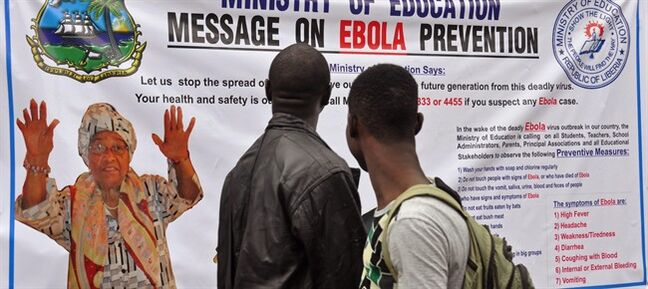 The image of Liberia President Ellen Johnson Sirleaf, left, appears on a public information banner warning people about the Ebola virus in the city of Monrovia, Liberia, Friday, Aug. 8, 2014. The World Health Organization urged nations worldwide to donate money and resources to stop the spread of Ebola as it declared the outbreak in West Africa to be an international public health emergency. (AP Photo/Abbas Dulleh)