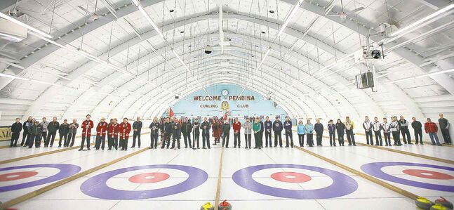 Curlers of all ages and gender form a line across the Pembina Curling Club for the opening ceremonies at the 126th Manitoba Open Bonspiel, formerly the MCA Bonspiel.