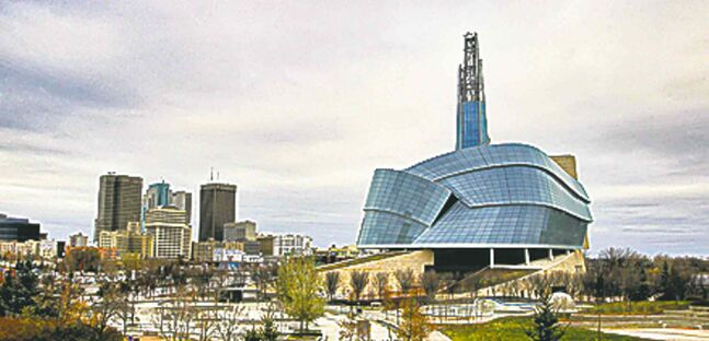 Winnipeg's downtown skyline with the CMHR in the foreground.