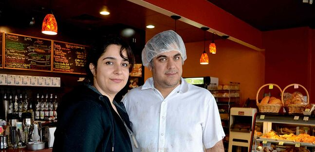 Ronak, left, and Peyman Estefani love their work, baking from scratch at  Cottage Bakery on Pembina Highway.