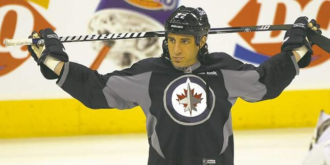 Winnipeg Jets Chris Thorburn stretches during practice Monday morning at the MTS Centre in Winnipeg.