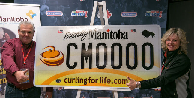CurlManitoba President Rob Van Kommer and Vice President Kim Warburton show off the new curling vanity license plates.