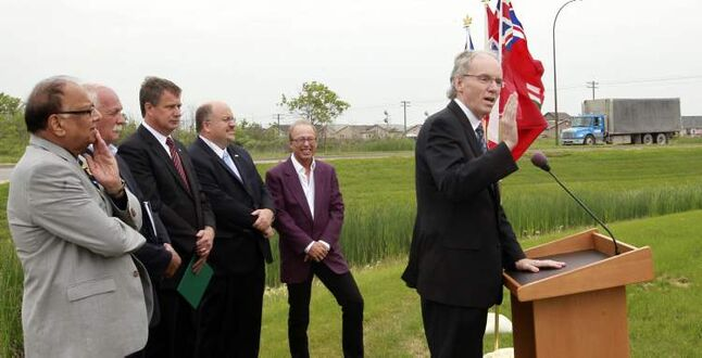 At podium, Steve Ashton, Minister of Infrastructure and Transportation, with (from left): Bidhu Jha, MLA;  Vic Toews, Minister of Public Safety;  Lawrence Toet, MP;  Transcona Ward Councillor Russ Wyatt and Mayor Sam Katz by the intersection of Dugald Road and Plessis Road Tuesday to announce in June 2012  that the project to widen Plessis Road and build a new rail bridge is another step closer to reality.  The Plessis Road twinning will now cost the city an additional $3 million even though it's not overbudget, thanks to a one-year delay in completion that negated the terms of a funding deal with Ottawa and Manitoba.