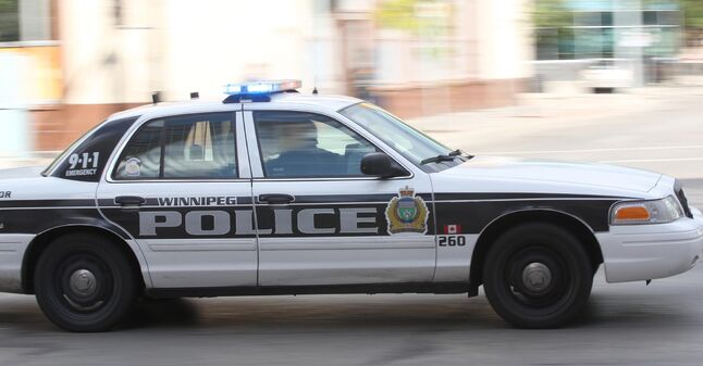 In this file photo a Winnipeg Police Service cruiser car responds with lights and sirens.