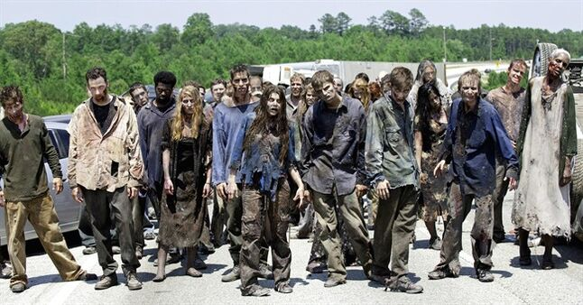 FILE - In this image released by AMC, zombies appear in a scene from the second season of the AMC original series,