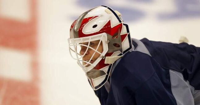 Chris Mason shows off a new mask at practice Friday.