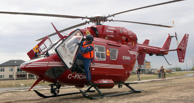A Stars Eurocopter BK-117 helicopter lands in Winnipeg's South Pointe.