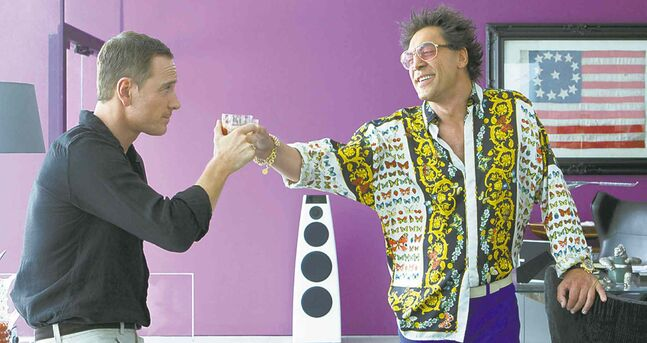 'Let's toast to terrible movies!': Fassbender (left) and Bardem.